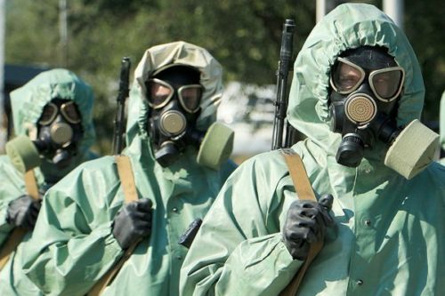 3 Soldiers in Biological Warfare Suits and Gas Masks